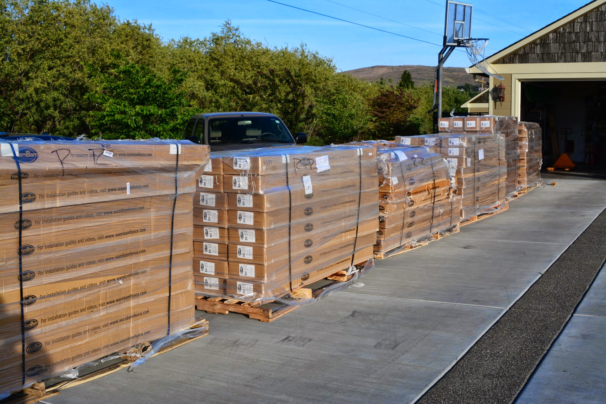 6 pallets of fence sitting in the driveway. He must have felt overwhelmed!