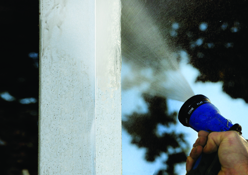 A simple spray of the garden hose is the best way to keep your vinyl fence looking fresh and new.