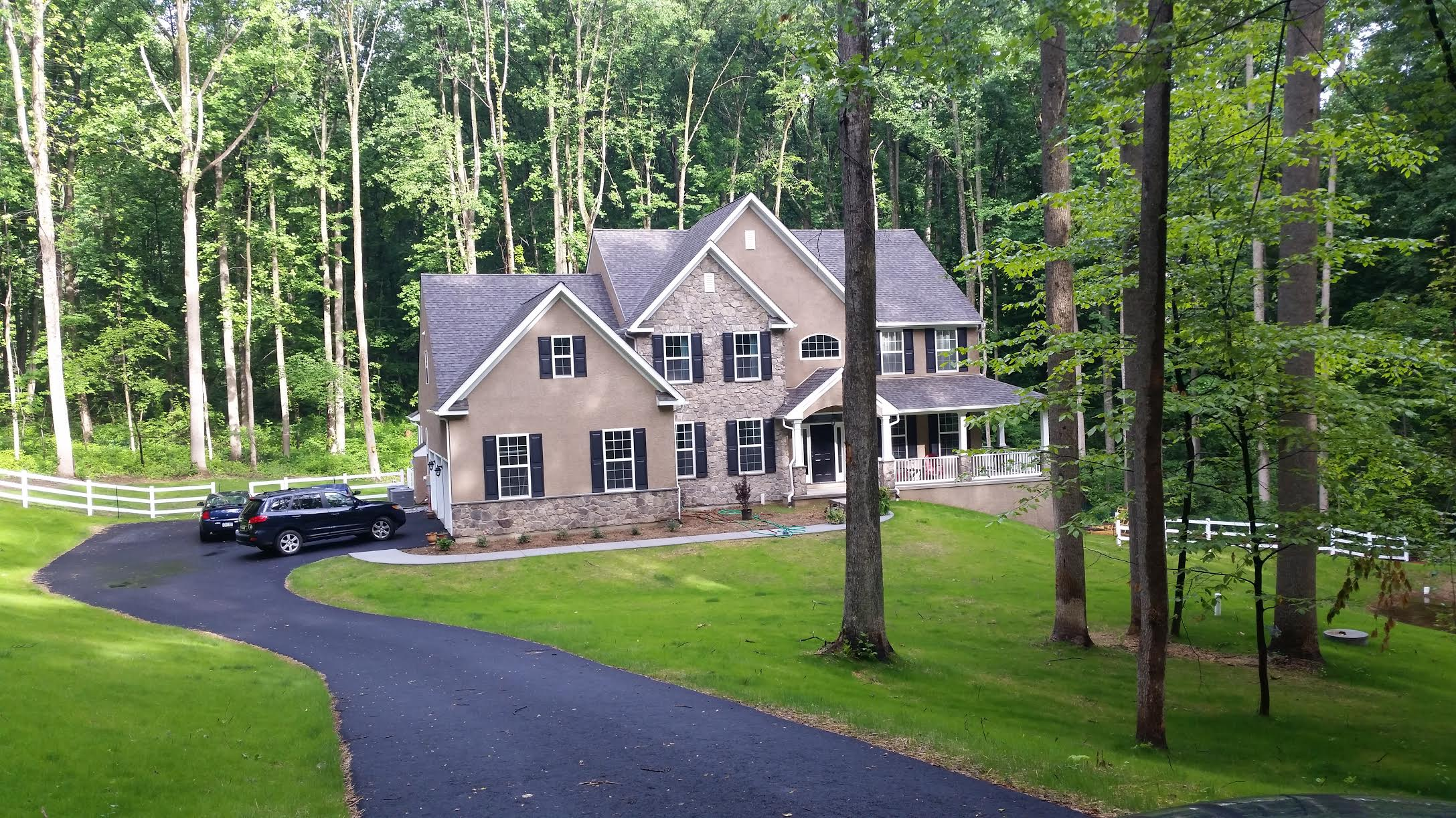 Larry has a beautiful home and property, and subtly defined borders with our 3-rail vinyl fence.