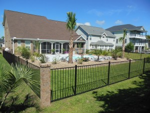 This is one of our favorite customer photos, where the grass is green! It features our aluminum fence.