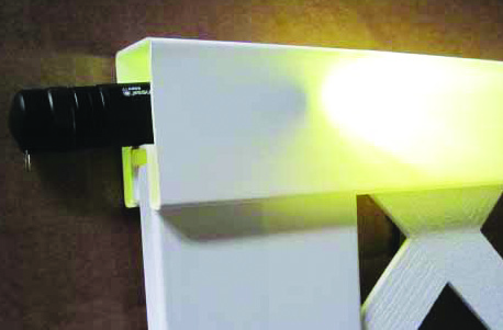 Shining a flashlight in the rail of a box store panel shows how translucent and thin the vinyl is