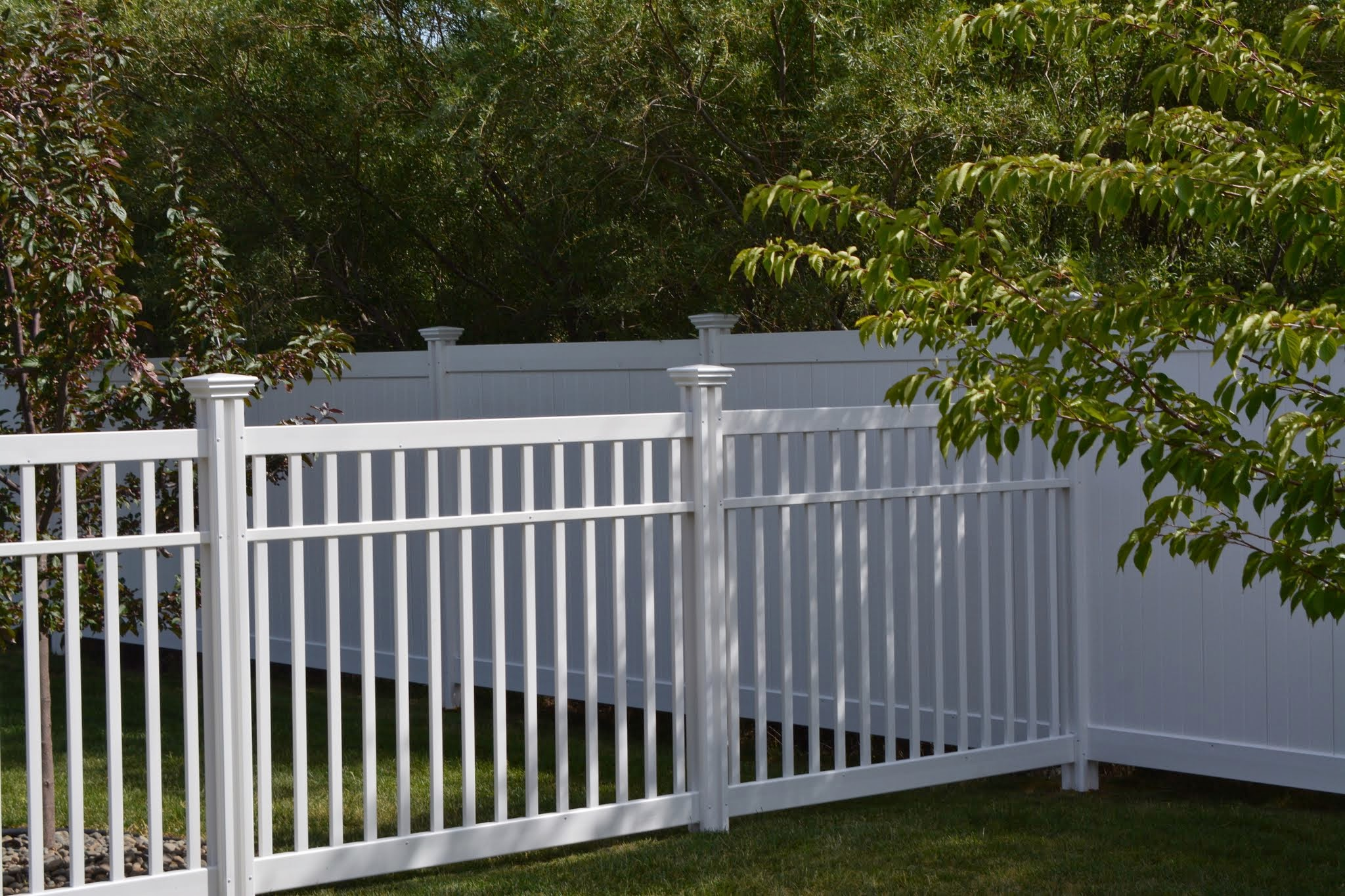 He ties the Nervous Nelly Vinyl Fence with the Steady Freddy Vinyl Privacy Fence.
