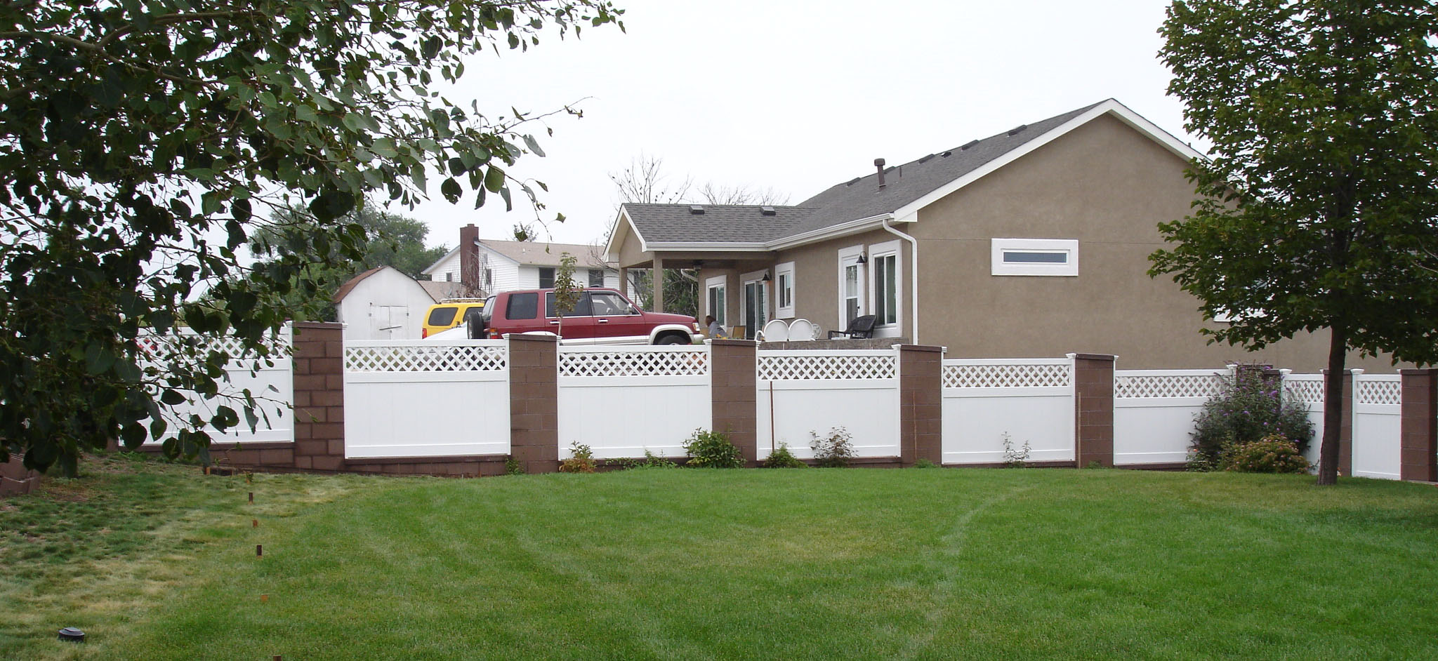 vinyl privacy fence with brick