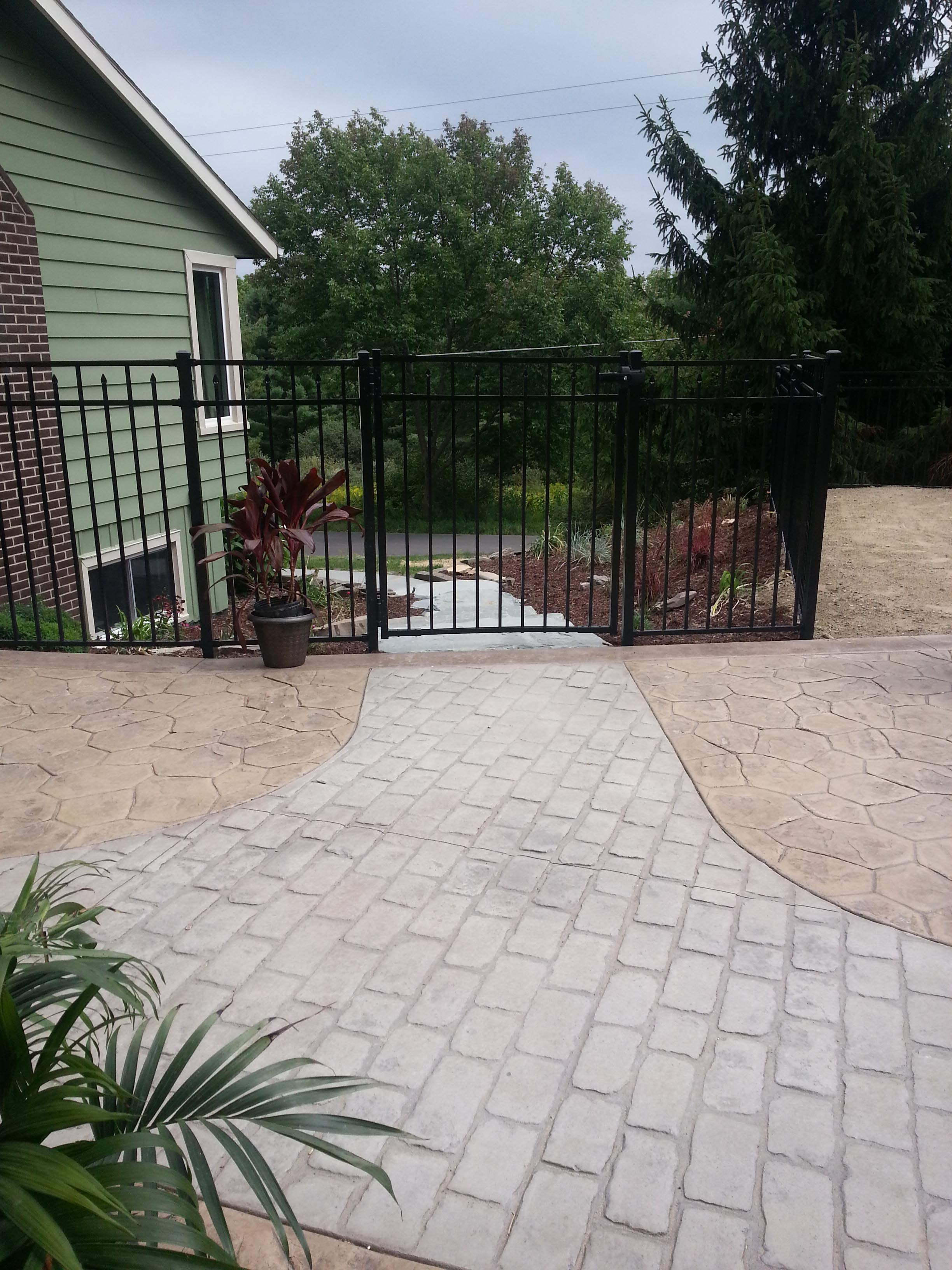 Another gorgeous entrance to the yard with an aluminum gate