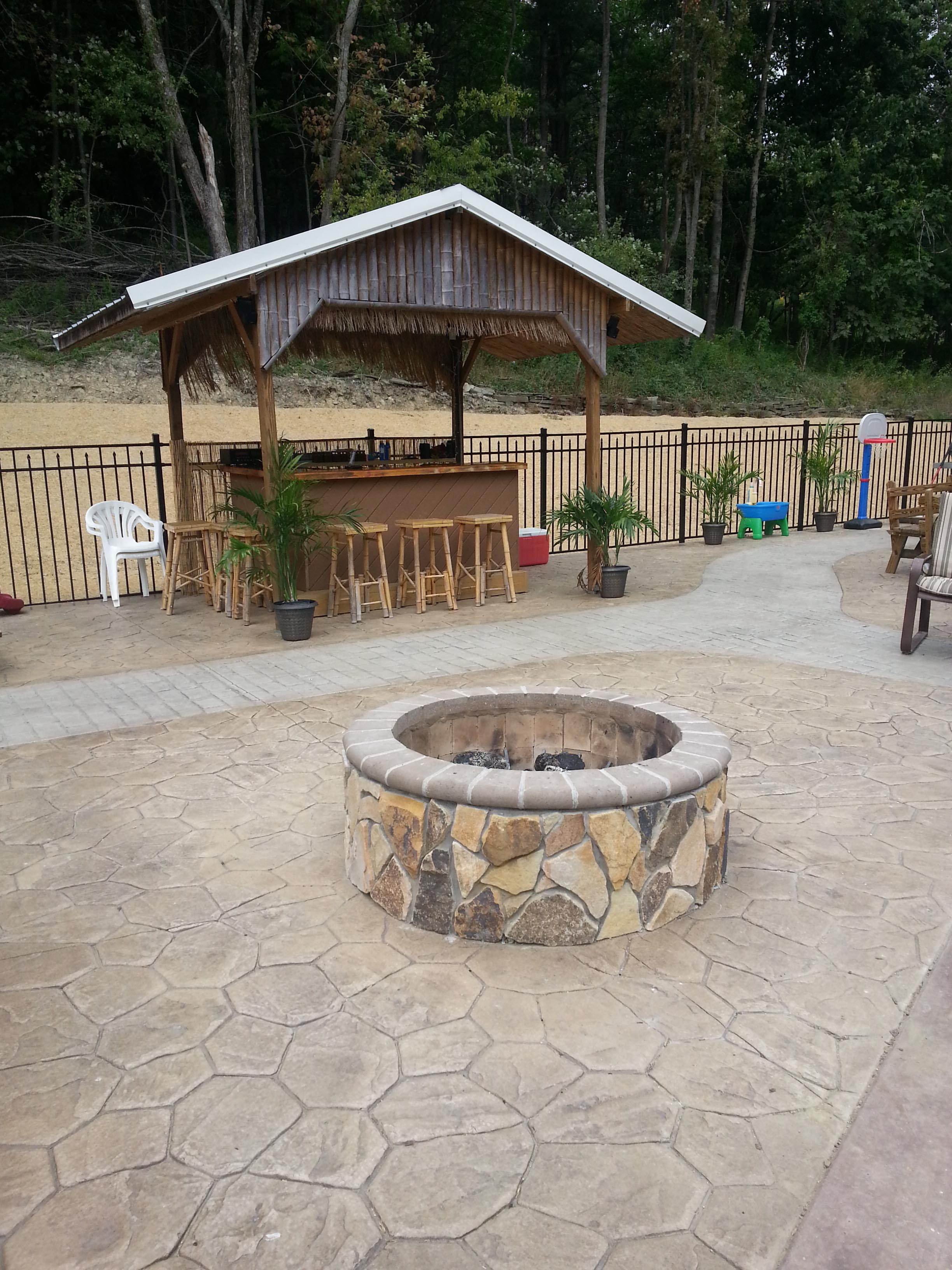 We love the fire pit and outdoor bar. Think Mike will invite us to any outdoor parties?!