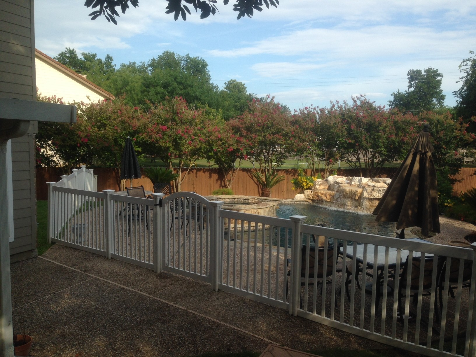 Brian surface mounted his fence to keep his pool safe.
