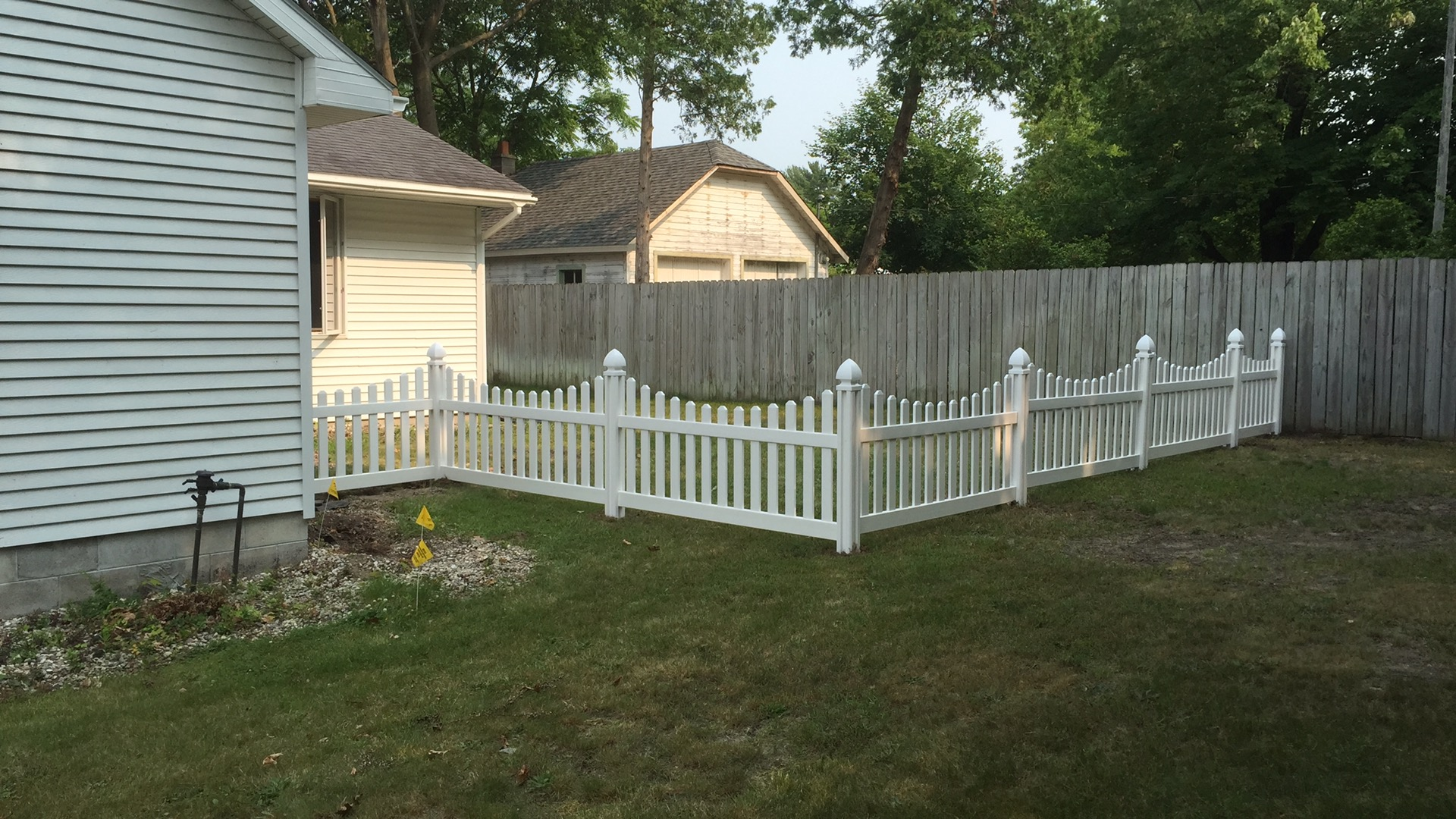 Mark shortened his Jiminy Picket vinyl fence and cut the pickets in a concave style (directions are included in the instructions).