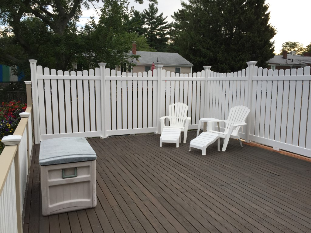 Wayne cut his Peeping Tom Vinyl Fence into a scalloped picket look and surface mounted on his deck.